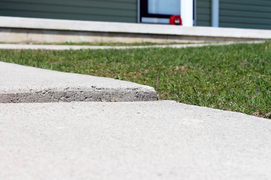sunken concrete sidewalk