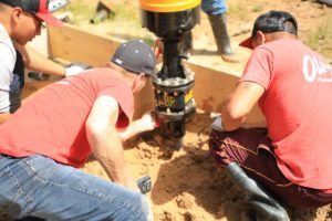 drilling helical piers at worksite