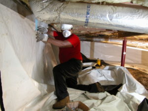 acrawl space encapsulation vapor barrier installation on wall