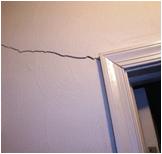 crack above door